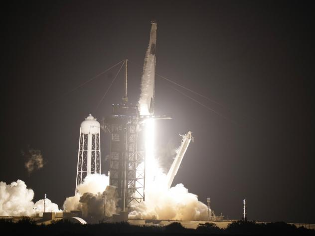 A SpaceX rocket, with the Crew Dragon capsule attached, lifts off from Kennedy Space Center Sunday in Cape Canaveral, Fla.