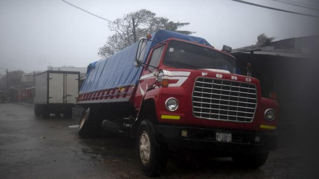 A truck flounders in a flooded street in Puerto Cabezas, Nicaragua, just hours before Hurricane Iota made landfall in the country Monday night. By Tuesday morning, the storm had significantly weakened, but it still poses life-threatening dangers for resi