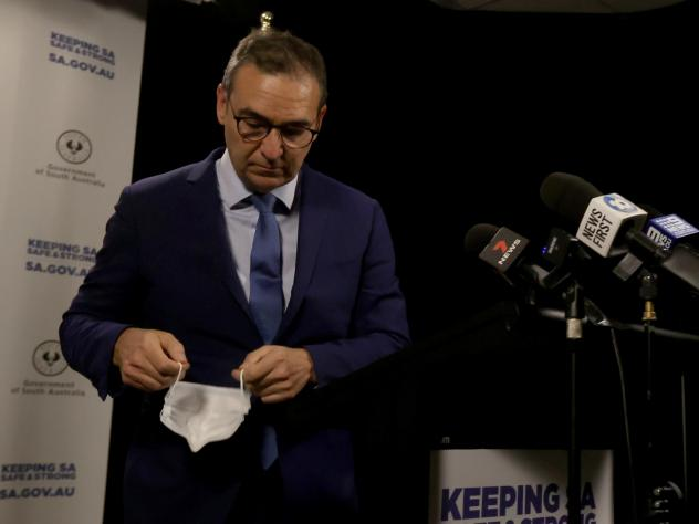 South Australian Premier Steven Marshall takes his mask off as he announces a 6 day lockdown for South Australia that takes effect midnight Thursday local time.