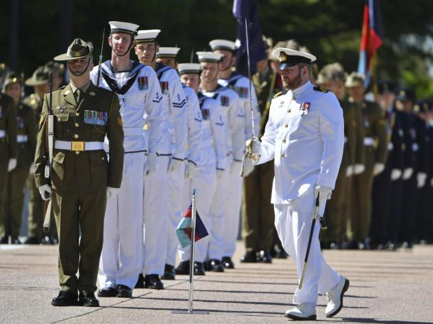 An honor guard is formed at Defence Headquarters in Canberra, Australia, before findings from the Inspector-General of the Australian Defence Force Afghanistan Inquiry are released on Thursday. A report found evidence that 25 soldiers unlawfully killed 3