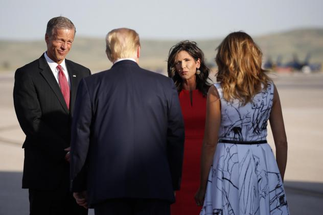Sen. John Thune, R-S.D., and Gov. Kristi Noem greet President Trump and first lady Melania Trump upon arrival in Rapid City, S.D, in July. Trump was en route to Mount Rushmore National Memorial.