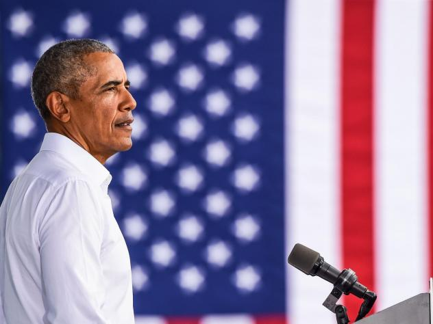 Former President Barack Obama speaks at a Biden-Harris drive-in rally in Miami on Oct. 24.