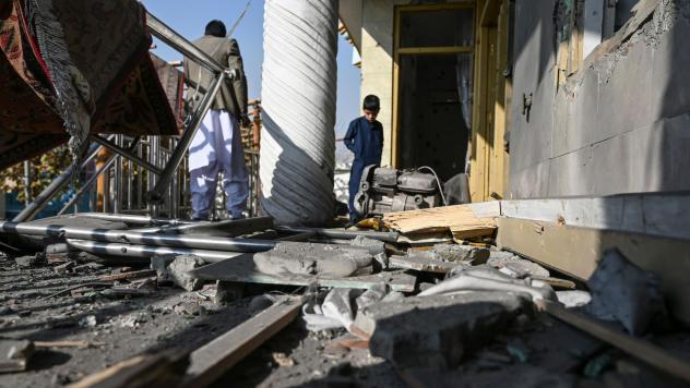 Residents inspect a damaged house after several rockets landed Saturday in Afghanistan's capital, Kabul. The Islamic State claimed responsibility for the attack, which comes the same day as U.S. Secretary of State Mike Pompeo's meeting with Taliban leade
