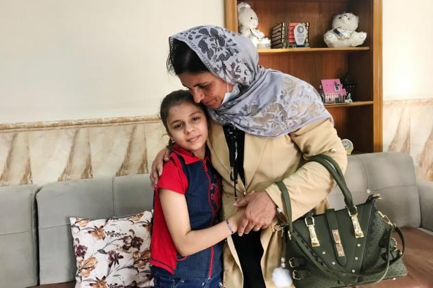 Kamo Zandinan says goodbye in the Mosul orphanage to a 10-year-old girl she believes is her daughter Sonya, taken from her by ISIS six years ago. The girl was rescued by police in March from an Arab family to whom she was not related. Zandinan is waiting
