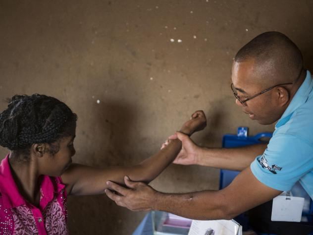 Nana (left) gets her birth control implant checked by Dr. Jean Rangomana during the Marie Stopes International mobile clinic in Besakoa, Madagascar, on April 9, 2018. Abortion is illegal under all circumstances in Madagascar, and Trump administration pol