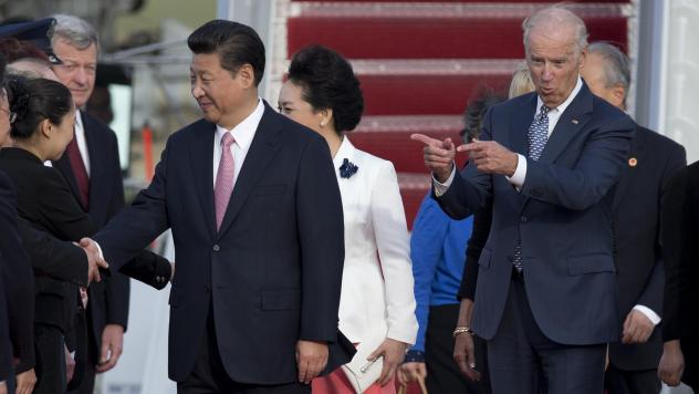 Then-Vice President Joe Biden gestures toward Chinese President Xi Jinping and his wife Peng Liyuan during an arrival ceremony in Andrews Air Force Base, Md., Sept. 24, 2015.