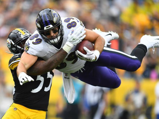Mark Andrews, right, of the Baltimore Ravens hurdles Devin Bush, left, of the Pittsburgh Steelers during the first quarter at Heinz Field on Oct. 6, 2019 in Pittsburgh. This season, the Thanksgiving matchup between the two teams has been canceled due to