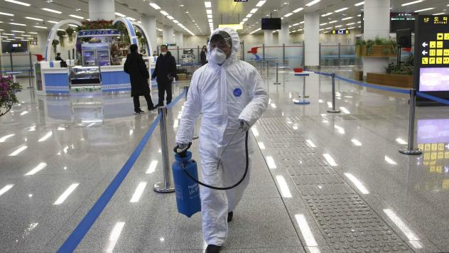 North Korean State Commission of Quality Management staff in protective gear carries a disinfectant spray can as personnel check the health of travelers and inspect goods delivered via the borders at the Pyongyang Airport in North Korea, on Feb. 1.