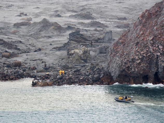 Recovery workers are seen at New Zealand's White Island last December. A volcanic eruption on the island killed 22 people and has led to work safety charges against tour operators.