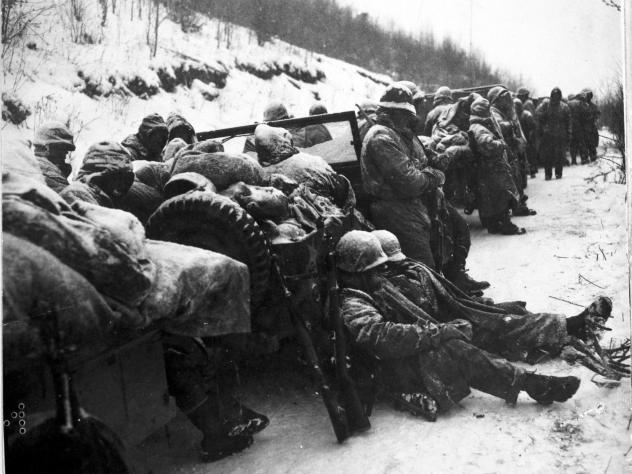 Marines of the 5th and 7th regiments who hurled back a surprise onslaught by three Chinese communist divisions wait to withdraw from the Chosin Reservoir area circa December 1950.