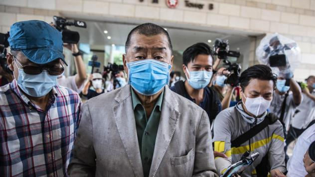 Hong Kong media mogul Jimmy Lai, seen here before a court hearing in September, has been formally charged under China's controversial new national security law.