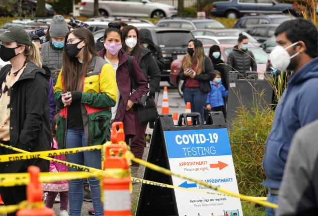People line up to be tested for the coronavirus at a free testing site Wednesday, Nov. 18 in Seattle.