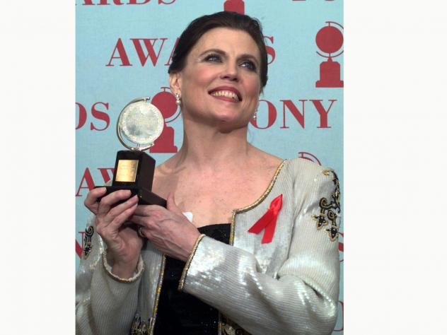 Ann Reinking, pictured holding her Tony Award for best choreography for the musical <em>Chicago</em> in 1997, died on Saturday, her family said in a statement.