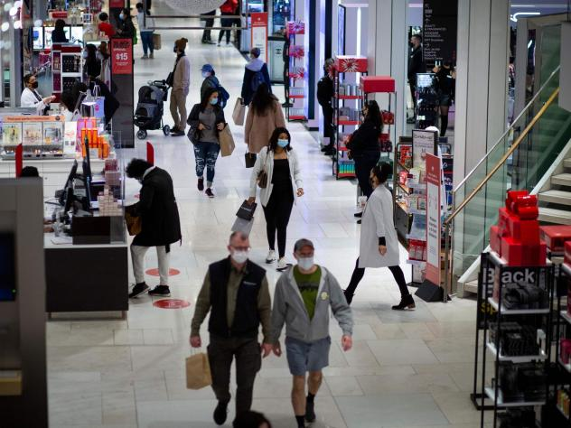 Shoppers walk through Macy's in New York on Black Friday last month. Retail sales declined 1.1% in November, according to the Commerce Department.