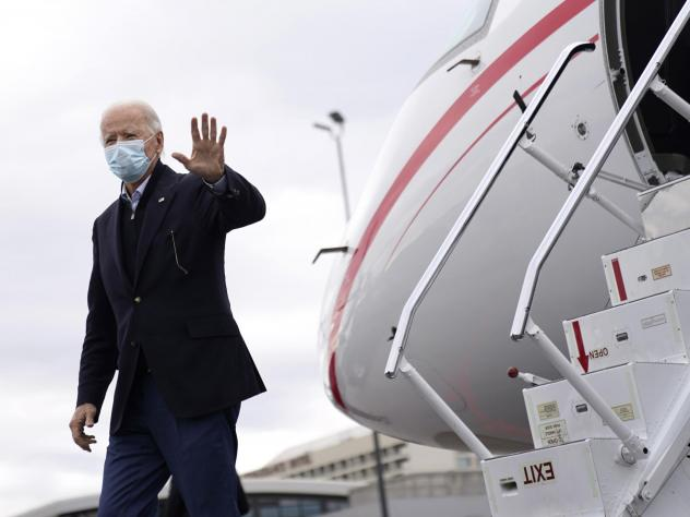 President-elect Joe Biden departs his plane before attending a drive-in rally for U.S. Senate candidates Jon Ossoff and Rev. Raphael Warnock.