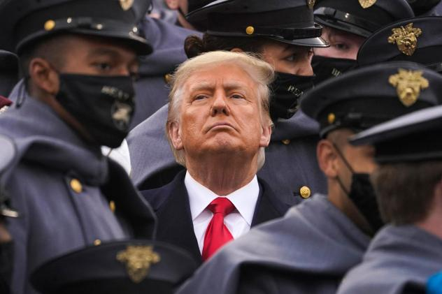 Surrounded by Army cadets, President Trump watches the Army-Navy football game at the U.S. Military Academy in West Point, N.Y., on Dec. 12.