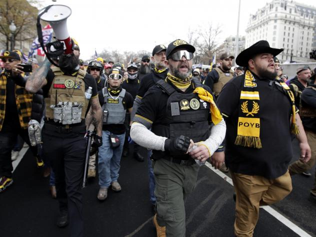 Demonstrators wearing clothes linked to the far-right extremist group  Proud Boys attend a pro-Trump rally in Washington last month.