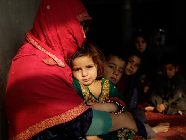 Shaista sits in her tiny home on the outskirts of Kabul. Her youngest, a 3-year-old girl, sits on her lap; some of her other seven children sit beside her. Behind them, she is boiling a pot of water on the wood-burning stove. But she's told the children