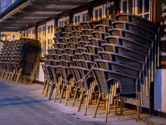 Chairs are piled up outside a restaurant Monday in the Baltic Sea resort town of Haffkrug, Germany.