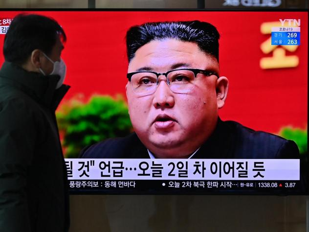 A man watches a television screen showing news footage of North Korean leader Kim Jong Un attending the 8th congress of the ruling Workers' Party held in Pyongyang, at a railway station in Seoul on Wednesday.