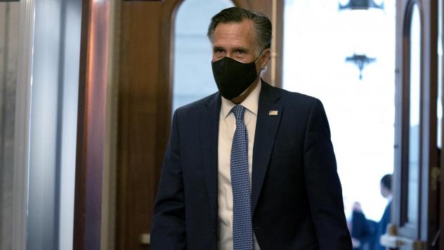 """""""President Trump has disrespected the American voters, has dishonored the election system and has disgraced the office of the presidency,"""" Sen. Mitt Romney told reporters Wednesday. Here Romney arrives at the U.S. Capitol last month."""