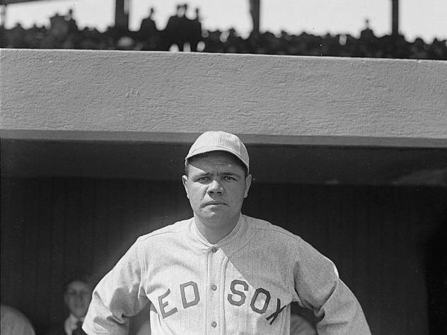 Babe Ruth, a pitcher for the Boston Red Sox, in 1918. That year, World War I and the Spanish flu pandemic slashed MLB game attendance by over half from what it was in the previous season.