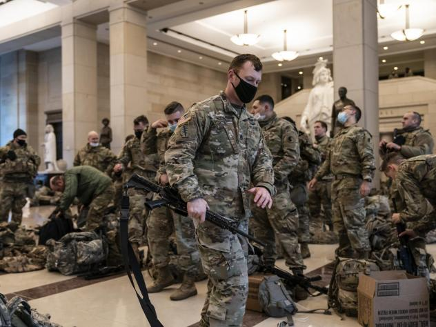 National Guard troops are inside the U.S. Capitol Visitor Center to reinforce security Wednesday at the Capitol in Washington. It comes a week after an insurrection at the Capitol.