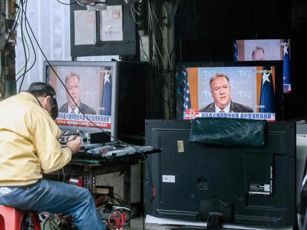 Televisions show a news broadcast of U.S. Secretary of State Mike Pompeo in Taipei, Taiwan, on Jan. 11. The Trump administration removed decades-old restrictions on interactions with Taiwanese officials just days before President-elect Joe Biden's inaugu