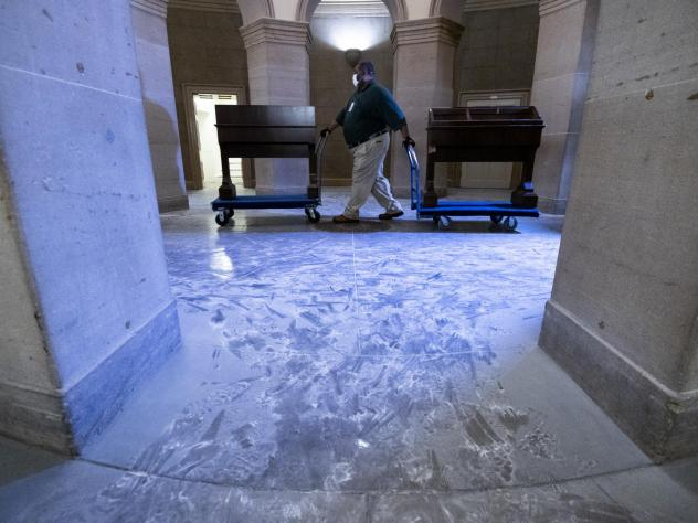 Capitol workers remove damaged furniture on from the U.S. Capitol on January 7, 2021, following the riot at the Capitol the day before.