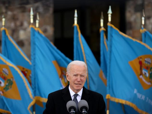 President-elect Joe Biden, seen here speaking in Delaware just before leaving for Washington, plans a flurry of executive actions as soon as he is sworn into office.