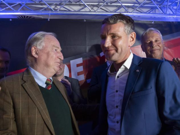 Alternative for Germany leaders Björn Höcke (right) and Alexander Gauland celebrate their party's election results in Erfurt, Germany, in 2019, when voters in Thuringia elected a new state parliament. The AfD now has 88 members in Germany's federal par