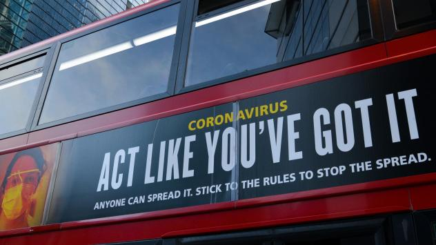"""Moderna will test new COVID-19 vaccine boosters, saying that while its vaccine should protect against variants found in the U.K. and South Africa, it isn't as effective against one strain.  Here, a bus in London carries a sign telling people, """"Act Like Y"""