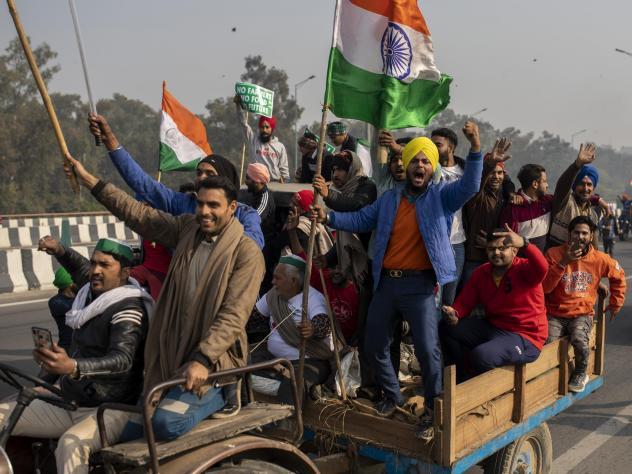 Protesting farmers riding tractors shout slogans as they march to the capital during India's Republic Day celebrations on Tuesday in New Delhi.