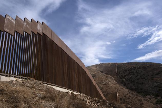 A reinforced section of the U.S.-Mexico border fencing seen in eastern Tijuana, Baja California, Mexico on Jan. 20. President Biden signed an executive action and has halted construction of the massive wall for 60 days.