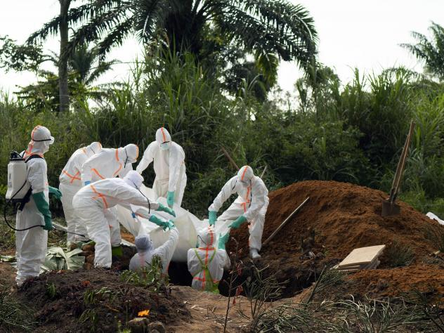 The Democratic Republic of Congo saw the end of its second-worst Ebola outbreak in June. More than 2,000 people died in that outbreak. Burial workers, seen above in 2019, follow safe burial practices to mitigate the spread of the virus.