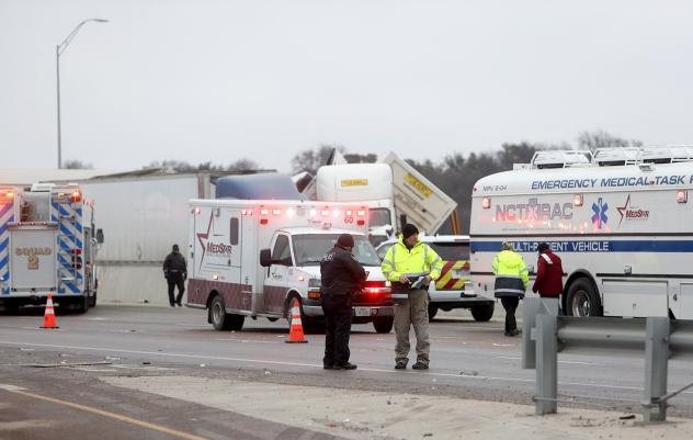 First responders arrive at the scene of a massive pile-up of vehicles on I-35W near downtown Fort Worth, Texas, on Thursday.