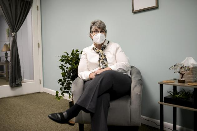 Jodee Pineau-Chaisson sits in her office in Springfield, Mass., on Jan. 12. Pineau-Chaisson, a social worker, contracted the coronavirus last May and continues to have symptoms even months after testing negative for the virus.
