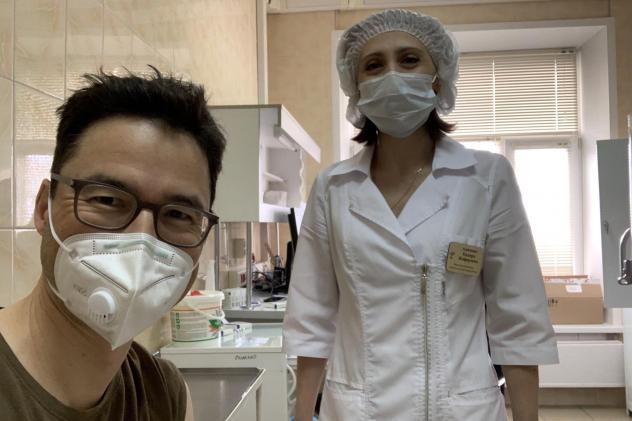 This week NPR Moscow correspondent Lucian Kim got vaccinated with Sputnik V, the COVID-19 vaccine that Russian President Vladimir Putin is promoting as the best in the world. Above: Kim smiles (behind his mask) after his shot.