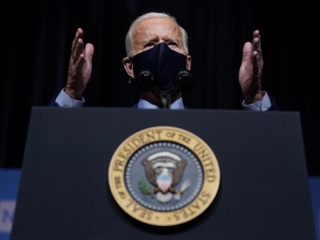 """President Biden said the attack on the Capitol """"has reminded us that democracy is fragile."""" Above, Biden speaks during a visit Thursday to the National Institutes of Health in Bethesda, Md."""