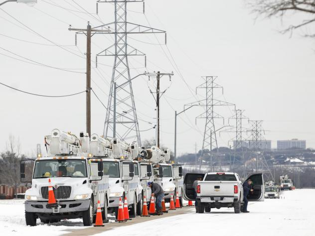 FORT WORTH, TX - FEBRUARY 16: Pike Electric service trucks line up after a snow storm on February 16, 2021 in Fort Worth, Texas. Winter storm Uri has brought historic cold weather and power outages to Texas as storms have swept across 26 states with a mi