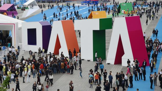 """Visitors walk past the giant word """"Data"""" during the Guiyang International Big Data Expo 2016 in southwestern China. China says it's determined to be a leader in using artificial intelligence to sort through big data. U.S. officials say the Chinese effort"""