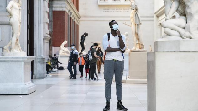 Visitors wear masks at the Metropolitan Museum of Art in October. The museum's director says the Met is considering selling art to pay for operating expenses.
