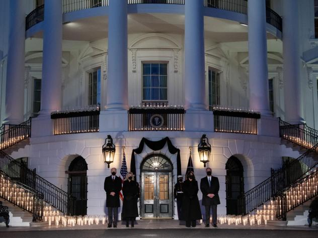 President Biden, first lady Jill Biden, Vice President Harris and second gentleman Doug Emhoff hold a moment of silence and candlelight ceremony in honor of those who have lost their lives to the coronavirus.