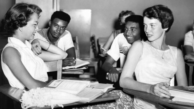 Students chat while waiting for history class to start at Oak Ridge High School in September of 1955, when the once all-white high school was desegregated by order of the Atomic Energy Commission. The Tennessee city's school board is now formally includi