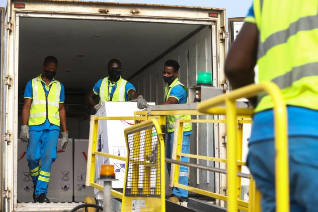 Ghana is the first country to receive a shipment of COVID-19 vaccines from the global COVAX program. Above: The vaccines are unloaded at the Kotoka International Airport in Accra on February 24.