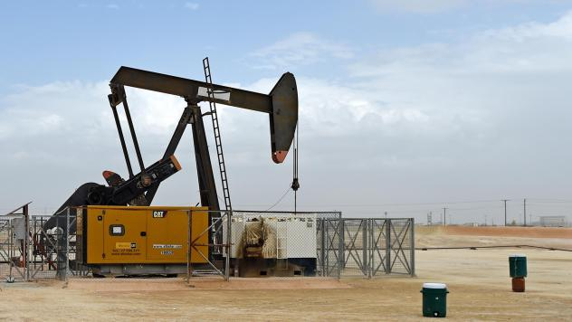 A pumpjack operates in the desert oil fields in southern Bahrain on April 22, 2020. Bahrain and other members of the OPEC+ alliance decided Thursday to keep output largely unchanged as they hope to push crude prices even higher after a recent rally.