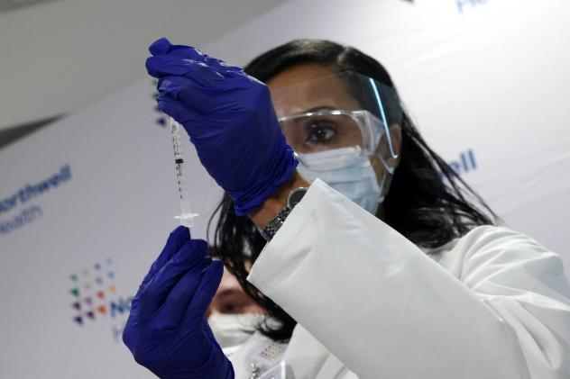 A medical worker at South Shore University Hospital gets ready to administer the newly available Johnson & Johnson COVID-19 vaccine in Bay Shore, N.Y., Wednesday. Clinical research found it to be 85% effective in preventing severe disease four weeks afte