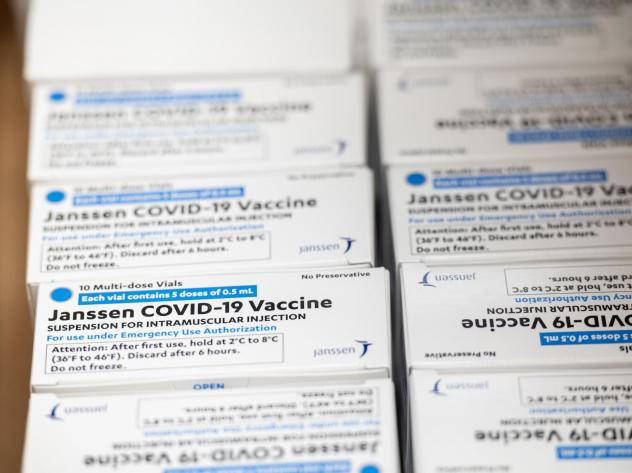 Boxes containing vials of the Janssen COVID-19 vaccine sit in a container before being transported to a refrigeration unit at Louisville Metro Health and Wellness headquarters on March 4 in Louisville, Ky. The FDA approved the third COVID-19 vaccine on F