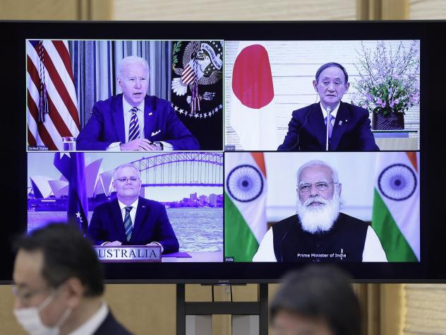 President Biden (clockwise from top left), Japanese Prime Minister Yoshihide Suga, Indian Prime Minister Narendra Modi and Australian Prime Minister Scott Morrison participate in the virtual Quadrilateral Security Dialogue or Quad meeting on Friday.