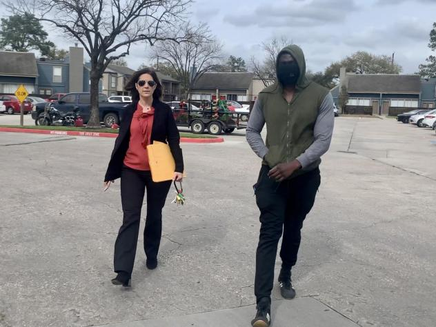 Landlord Stephanie Graves walks to the main office at one of her properties in Houston with a resident. She's going door to door offering to help residents apply for rental assistance money approved by Congress that's just starting to flow to landlords a